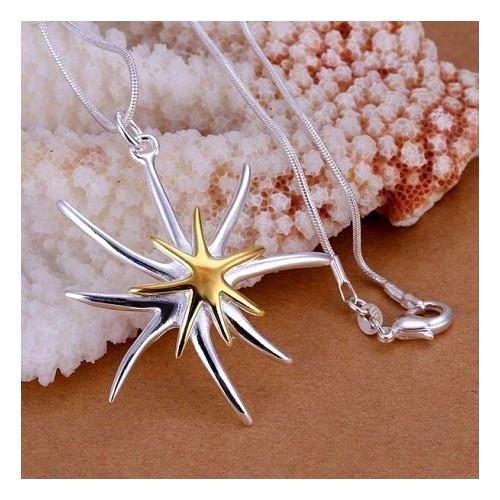 Srebrny naszyjnik z ciekawym motywem